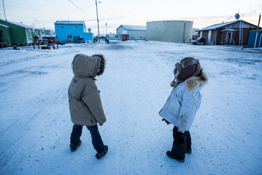 Kivalina kindergartners Damian Frankson, left, and Randy Swan walk home after school at -40 degrees