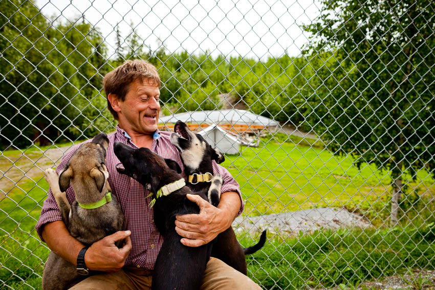 "Iditarod record-holder Martin Buser with the ""Palin Litter."" Each dog is named for a member of Sarah Palin's family"